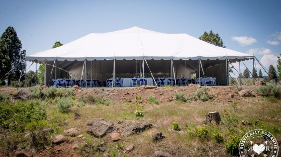 A Tent In A Field With Mauna Loa In The Background